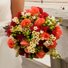 Maybe sunflowers instead of roses or yellow roses instead of the shades of red bridal bouquet