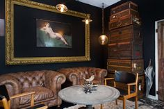 An elegant scene in our showroom. Kensington cigar chairs and a pair of Arne Vodder wood and leather arm chairs. Custom lighting and vintage Louis Vuitton steamer trunks. Antique home decor. http://bdantiques.com/