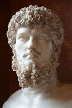 Colossal head of Lucius Verus (mounted on a modern bust), from a villa belonging to him in Acqua Traversa near Rome, between 180 and 183 AD, Louvre Museum, Paris.