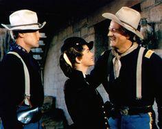 """John Agar, Joanne Dru and Duke in """"She Wore A Yellow Ribbon"""" (1949)."""