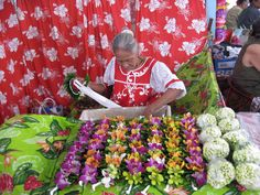 Flower lei stand in Tahiti.  Photo taken by Tahiti specialist Marie Glodt