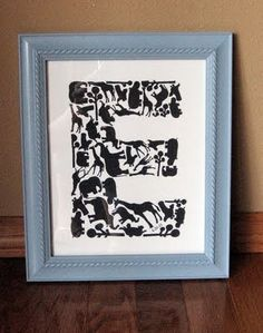 "tweak this idea with fabric..... a nice chunky font (Berlin Sans) for my letter ""E""and blew it up to about 700 point size for an 8x10 frame"