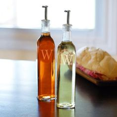 Our Oil & Vinegar Cruet Bottles are thetasty duo that no kitchen will be complete without Constructed of hand blown glass, the curvedbottles pair up to provide your cooking station with aunique, customizedlook. Fill with colorful liquids for creating tasty meals everyone will enjoy. Features a silver metal stopper and your own customization, these ultra chic kitchen accessories will be used, and treasured,throughout the years  Details:Size: Measures