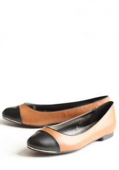 """Exquisite Authority Cap Toe Flats 34.99 at shopruche.com. These whiskey colored faux leather flats are perfected with rounded toes, black toe caps, and gold colored accents.All man-made materials, 0.5"""" heel.  Perfect with my black and tan skirt."""
