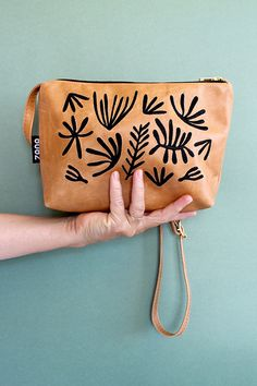 Leather bag with leaf motif by Zana Products