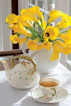 Pair a beautiful and festive Belleek Shamrock tea set with a vivacious bouquet of yellow blossoms to celebrate Saint Patrick's day with tea.