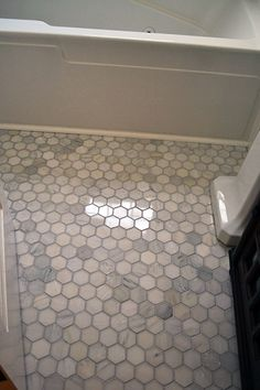 Marble Hex Floor Tile: $300 for a small bath space