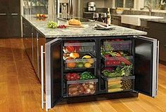 Love this great way to store produce! It keeps it handy to the work surface and allows for lots more controlled humidity than most standard refridgerators (if each side has a separate control). Whoever staged this shot, though, needs a lesson in what goes together!