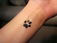 cute dog paw wrist tattoo