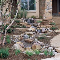 A beautiful entryway, and a great job of echoing the color and shape of the rock facing used on the house!