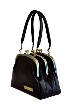 Three-clasp Leather Bag - Love the really individual style of this
