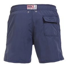 """BLUE OWNER P SWIM SHORTS WITH SKULL Solid dark blue Long Swim Shorts featuring a skull and """"PIRATES DE SAINT BARTH"""" embroidery at lateral side. Two front pockets and back Velcro pocket. Internal net. Elastic waistband with adjustable drawstring. COMPOSITION: 100% POLYESTER. Model wears size M, he is 189 cm tall and weighs 86 Kg."""