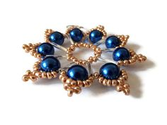 handmade seed bead star ornament in gold silver and blue by Kreativprodukte, €8.50