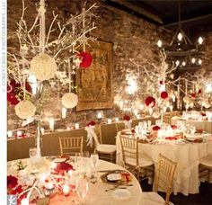 The couple chose The Champagne Cellar for its delicious food and warm ambience. The decorated the tables with tall white branches that dangled rose pomander balls, candles, and crystals over the gold organza-topped tables.
