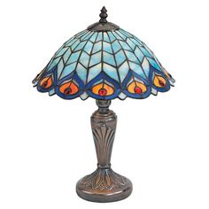 Features:  -Table lamp.  -Hand-cut stained glass shade.  -Switch on cord.  -Bronze finished.  Base Color: -Bronze.  Hardware Finish: -Stainless steel.  Fixture Material: -Plastic.  Hardware Material: