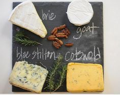 serve cheese labeled on slate board with chalk.  i have lots of slate.  christmas party idea.