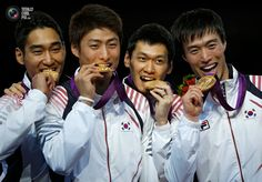 Day 7 - South Korea's fencing team pose with their gold medals during the men's sabre team fencing competition victory ceremony at the London 2012 Olympic Games. DAMIR SAGOLJ/REUTERS