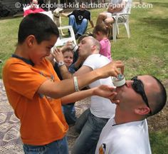 Bottle Chugging Contest - Prepare baby bottles with 40 ml of soda. Each child chooses a grownup who cannot use their hands while the child feeds them the bottle.  The first grownup to finish the bottle AND burp - wins.  Funny for just adults as well.