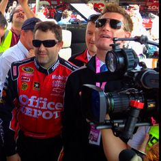 Tony Stewart gives ESPN's Marty Smith an unexpected (and apparently painful) butt-pinch.
