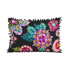 Bold flowers in beautiful embroidery light up the fabric of this fun, daring pillow. Down to its bobbled trim, it's a perfect boho-glam addition to an eclectic armchair.