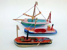 Artfully painted and modelled toy boats by English painter, sculptor and visual artist Sam Smith (1908-1983), as seen at sam-smith.org/
