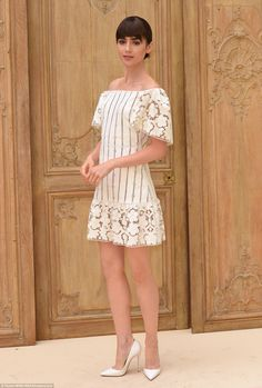 Pretty as a picture: Lily was an absolute vision in a Bardot neckline cream dress with str...