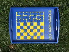 13x9.5 pine wood tray checkers/chess game, available in multiple color combinations. Up to three colors may be chosen: tray color, vinyl checkboard color and vinyl name color (must be specified in order comments). Colors for the pieces will be based as closely as possible on the vinyl color choices.  Checkerboard option includes 26 wooden game pieces (1 extra of each color). Chessboard option (+$3) includes 32 wooden game pieces with vinyl chess icons on one side.  Each game tray is custom…