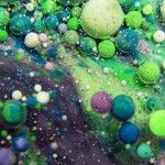 Paint, Oil, Milk, and Honey Mix in this Surreal Macro Video of Swirling Liquids by Thomas Blanchard