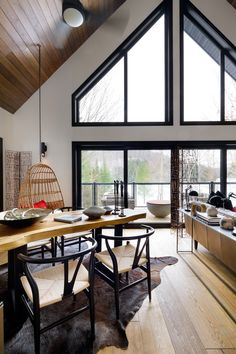 Before & After: Interior Designers Colin McAllister and Justin Ryan Spruce Up Their Canadian Cottage Love this open space look, neatly framed with black windows. Black Window Frames, Black Windows, Large Windows, Wall Of Windows, Black Frames, House Windows, Window Wall, A Frame Cabin, A Frame House