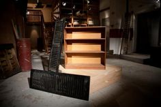 """For their """"Stealthy Storage"""" project, teammates Dani and Mo purchased an old bookcase and pair of black shutters."""