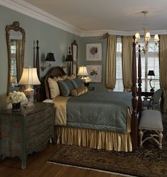 Traditional, elegant bedroom in soft blue and cream. Notice the large mirrors, rug, etc.