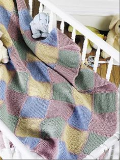 The classic Baby Blocks Blanket is a perfect gift for any little one on the way.  Download this and other free baby blanket knitting patterns at Freepatterns.com