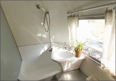 BIG SUR AIRSTREAM RENOVATION: Here's the updated bathroom, made fresh with a coat of white paint.