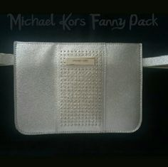 """Michael Kors Silver Studded Belt Bag Look chic in the city with this stylish belt bag from Michael Kors, crafted in fine leather with microstud detail. Approximate width: 1/2"""". Approximate size medium: 40"""" length. Approximate size large: 42"""" length. Bag: 7""""W x 5""""H. Michael Kors Accessories Belts"""