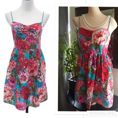 """Fun & Flirty Bright Floral Summer Dress Flirty floral spring/summer dress. Adjustable spaghetti shoulder straps. Front sweetheart cut with double lined cups. Seen elastic detail across back for a comfortable fit. Loose fit skirt, no lining. Bust 14"""" (Flat) Waist 13"""" (Flat) Hips 19"""" (Flat) Length 31"""" Falls above knee.              100% Cotton. Juniors Size Small Xhilaration Dresses Mini"""