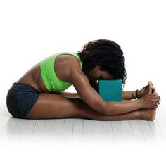 Practice Seated Forward Fold to soothe a headache and thwart oncoming migraines.