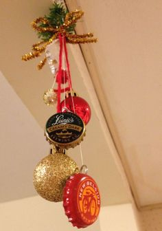 Easy Christmas decor, hang mini ornaments, beer caps, pom poms & yarn from mini wreath. For the beer drinker in all of us!