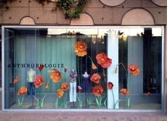 Anthro store front. I want to see giant flowers in a photo booth or as party decor!
