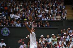Federer serves.  2015 Wimbledon Championships Website - Official Site by IBM