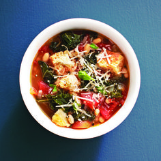 Hearty Tuscan soup Recipe Soups with olive oil, onions, garlic cloves, low sodium chicken broth, water, navy beans, diced tomatoes, kale, croutons, fresh basil, grated parmesan cheese