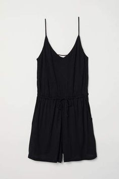 Sleeveless jumpsuit in soft viscose jersey. Double layers at top shallow V-neck narrow shoulder straps and elasticized seam and drawstring at waist. Side pockets and short wide legs. Black Romper, Black Jumpsuit, Fashion Art, Fashion Online, Corsage, Cold Weather Outfits, Fashion Company, Neue Trends, Everyday Fashion