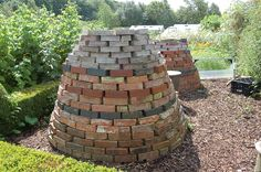 Brick Composters.  The bricks are heated by the sun and their warmth is transferred to the compost, thereby aiding decomposition.  These composters were created by the much missed BBC Gardener Geoff Hamilton and can be seen at his Barnsdale Gardens in Rutland.
