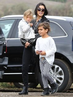 Style: Her big brother wore similar plaid trousers with Doc Martin boots and a white pullover