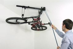 Floaterhoist Horizontal Bike Lift Hoist Garage Bicycle Storage Pulley System -- Visit the image link more details. Garage Storage Solutions, Diy Garage Storage, Garage Organization, Storage Systems, Storage Ideas, Storage Racks, Organizing, Bike Storage Hoist, Indoor Bike Storage
