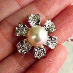 Silver flower with clear rhinestones and white pearl. Great for cell phone deco, scrapbooking and any jewelry making, etc.  Size: 2.4cm (Diameter)