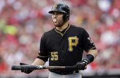 Pittsburgh Pirates' Russell Martin walks to the dugout after striking out against the St. Louis Cardinals in the third inning of Game 1 of baseball's National League division series on Thursday, Oct. 3, 2013, in St. Louis. (AP Photo/Charlie Riedel)
