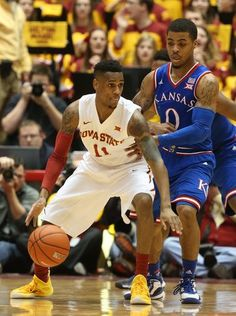 Iowa State's MontŽ Morris handles the ball while being
