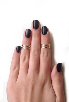 Double Knuckle Rings. @Kasey Collins Collins I think you need these.