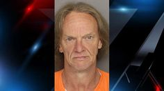 Man accused of dragging dog behind truck faces upgraded felony charge