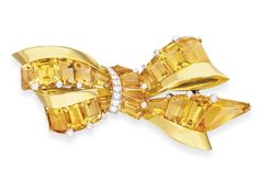 ETRO CITRINE, DIAMOND AND GOLD BROOCH, BY OSCAR HEYMAN & BROTHERS FOR J.E. & CALDWELL Designed as a calibré-cut citrine and 18k gold ribbon bow brooch, circa 1945. Signed J.E.C. & Co. for J.E. & Caldwell; maker's mark for Oscar Heyman & Brothers